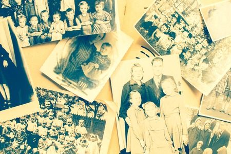 Khabarovsk / Russia - 04.02.2018: Family album with old photos. Children, men and women. Family history, ancestors, relatives. Vintage style, top view.