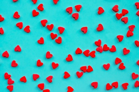 A cheerful, romantic background, small hearts on a light blue surface. Valentines Day, an explanation in love, tender feelings. Reklamní fotografie
