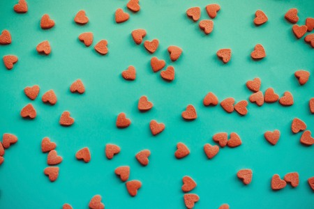 Small red hearts on a calm blue background. Explanation in love, Valentines Day. Toning, top view. Stock Photo