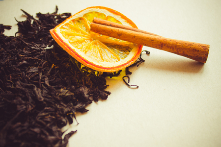 Cinnamon, orange and dry black tea. Large selective leaves, the highest grade. Daylight, toning, copy space.