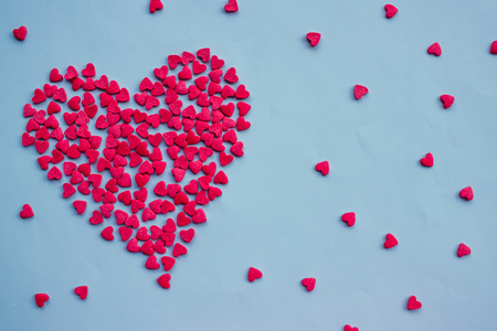 A large heart consists of small ones. Calm light blue background, copy space. Love, valentines day, tender feelings. Stock Photo