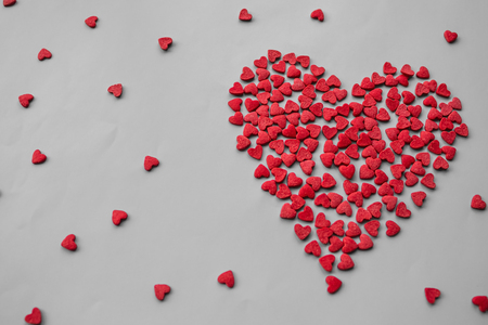 A declaration of love, strong feelings, passion. The big red heart consists of small ones. Light background, top view.