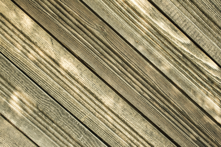 Old wood, natural cover. Unpainted boards diagonally, warm colors. Country style, countryside.