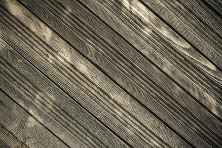 Wooden cover, old unpainted boards. Arrangement diagonally, daylight. Calm natural tones. Stock fotó
