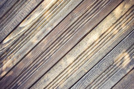Large boards diagonally. Timber, wood paneling. Natural texture. Daylight, toning.