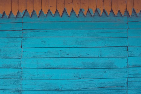 Blue background from old, faded boards. Wooden wall of a country house, handmade, carpentry craft. Retro style, without pattern. Horizontal stripe, vintage toning.