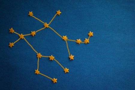 Gemini constellation on a blue background. Astrological forecast for born in June. The influence of stars on fate. Top view, drawing made by the author.