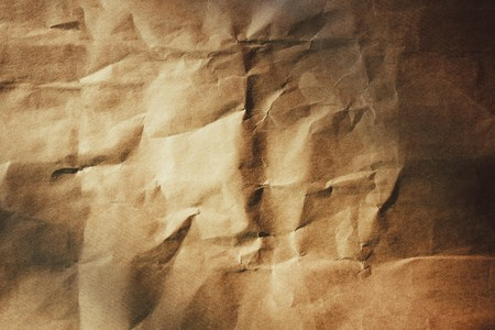 Simple, rough paper without a pattern. Natural texture, organic packaging. Vintage toning, side lighting. Stock Photo
