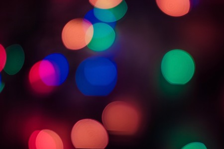 Festive background, party, night illumination. Bright circles of different colors, everything is blurry. Holiday, fun.