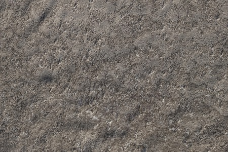 Gray background, earth, soil. Neutral natural surface. View from above.