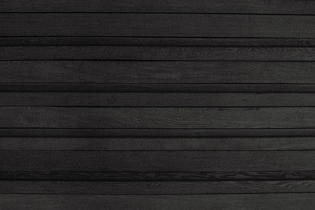 Gray wooden surface, lumber, wood paneling. Neutral surface. In black and white.