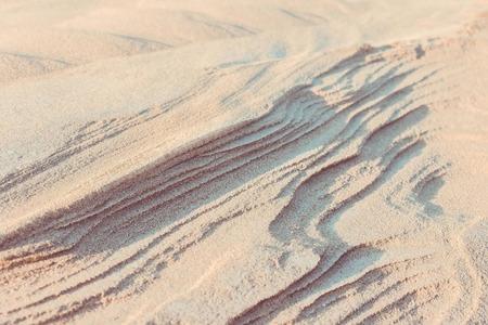 White sand, bright sunlight. Desert, drought, natural landscape.