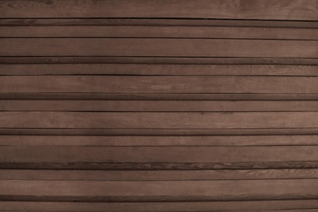 Gray wooden surface, boarding. Parallel horizontal stripes. Natural texture, muted tones.