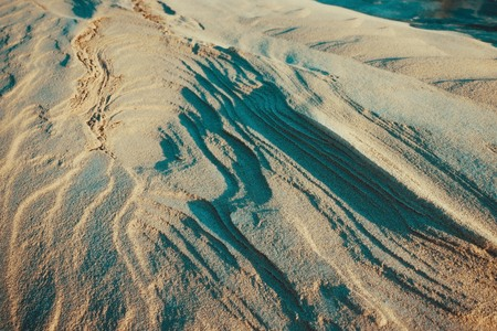 Sandy mountains, dunes, natural landscape. Layered structure, abstraction. Lateral solar lighting. 스톡 콘텐츠