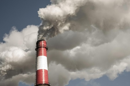 Industrial emissions, air poisoning, poor ecology. White thick smoke from a huge pipe. Muffled tones, vignetting.