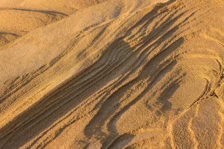 Sand dune stratification. Natural landscape. Lateral sunlight, evening. 스톡 콘텐츠