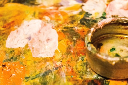 Artists palette, bright color spots. In the foreground oiler. The edges are blurred.