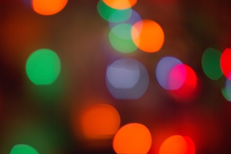 Bright, colored background. Everything is blurry, abstraction. Festive, night lighting. Red, orange, blue and green tones. Imagens