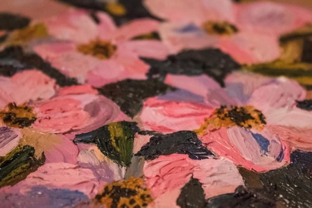 Art, oil painting, fragment with flowers. Large strokes, flowers with pink petals. The background is blurred.