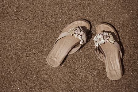 Summer, heat, holiday season. Rest, travel, vacation. Brown sand, muted tones, vignetting. Imagens