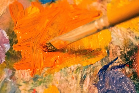 Oil painting, art, skill of the artist. Bright colors on the palette. Talent, creativity. The edges are blurred.