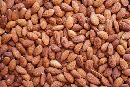Peeled almonds, a natural source of vegetable protein and vitamins. Vegetarian menu, fasting, diet. Top view, daylight. Imagens - 122434486