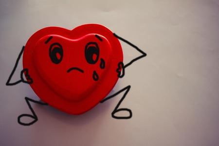 Sad, lonely heart. Melancholy, thoughtfulness, longing. Light background. Figure made by the author. Imagens - 122434489