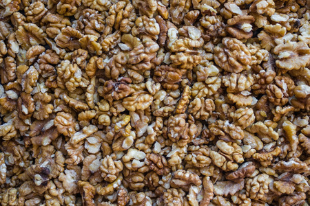 Lightly brown walnuts, useful, nutritious food. Vegetarian menu, post. Healthy lifestyle, proper nutrition. Daylight, top view.