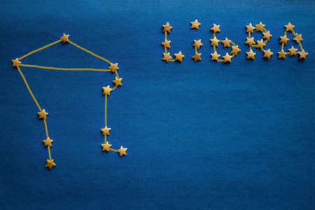 Zodiac sign, eastern horoscope, astrological prediction. On a blue background a small star is lined with a constellation of Libra. The picture is made by the author. Banque d'images