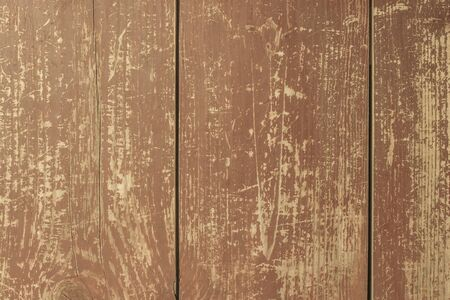 Old wooden surface, a lot of large and small scratches. Natural texture. Brown paint peeled off. Vintage style.