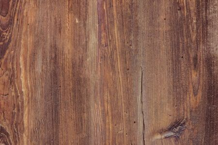 The texture of a natural wooden board. Unpainted surface, brown and gray tones.
