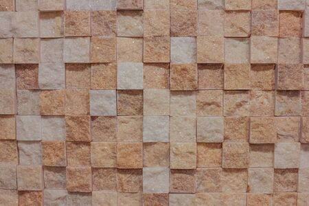 Marble cubes, rough surface, unpolished stone. Pink, brown, beige and white shades, abstraction. Interior decoration.