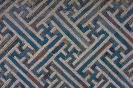 Concrete wall with a fancy ornament, decor element. Blue lines, swastika symbol. Skillful work. Stok Fotoğraf