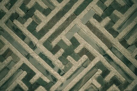 Lines on a gray concrete surface, ancient ornament. Muted tones. 版權商用圖片
