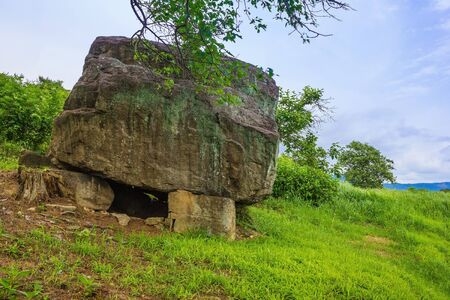 Ancient stone burial, grave of an ancient man. Around the green grass. South Korea, a cultural heritage site.