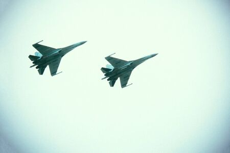Modern military aviation, jet aircraft. Armed conflict, military threat. Cloudy sky, vignetting. Stok Fotoğraf