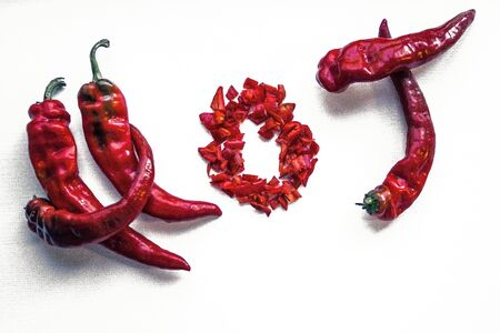 Pods of red hot pepper, spice. The inscription is hot on a light background. Toning, top view. 版權商用圖片