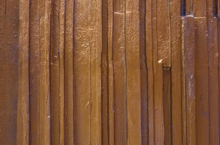 Embossed texture, vertical stripes. Wall, element of decor. Gold plating.