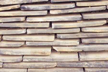 Gray, dirty texture. A pile of tiles. Narrow horizontal stripes, parallel lines. Фото со стока