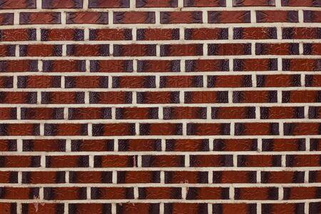 Narrow rectangular tiles, horizontal lines. Dark brown tones. Фото со стока