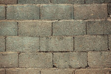Large bricks, masonry. Dead end, blank wall. Vignetting.