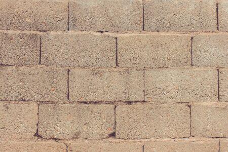 Calm, neutral texture. Gray bricks, parallel lines. Natural lighting. Фото со стока