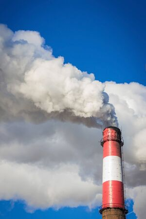 Industrial emissions, global warming. Bright blue sky, white thick smoke. Solar lighting, vignetting.