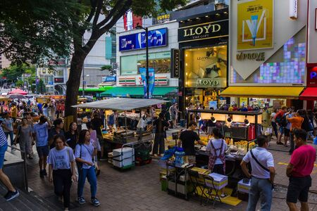 Seoul / South Korea - 07/29/2019: Shopping centers, street food and tourists in the center of Seoul. Traveling in Asia. The capital of South Korea. Editorial