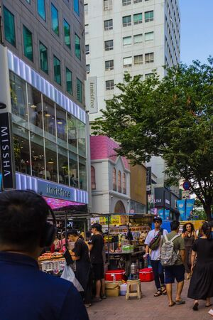 Seoul / South Korea - 07/29/2019: A busy, tourist street in the center of Seoul. A lot of people, street vendors. Traveling to South Korea, summer day.