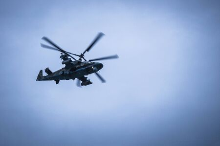Helicopter in the blue sky. Air Force, aviation support. View from below. Vignetting. Stock fotó