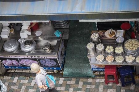 Busan / South Korea - 07/09/2019: City street, food stalls. Local culture and traditions. View from above.