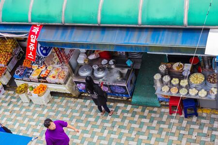 Busan / South Korea - 07/09/2019: City street, mid day. Trade in fruit and junk food. Traditional korean food. View from above. Éditoriale