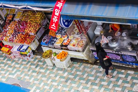 Busan / South Korea - 07/09/2019: Local market in Busan, food stalls. The culture and traditions of Korea, everyday life. View from above. Éditoriale