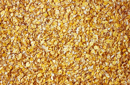 Bright yellow background of oatmeal. Delicious, healthy breakfast, sports diet.